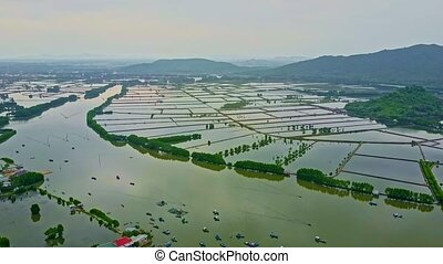 Aerial View Wide River under Flood against Mountains -...