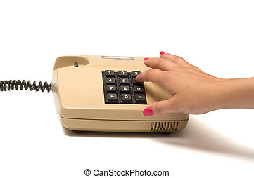 Hand and telephone. - Female finger presses the button on...