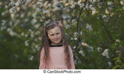 Child in the spring garden - Emotional child in the spring...