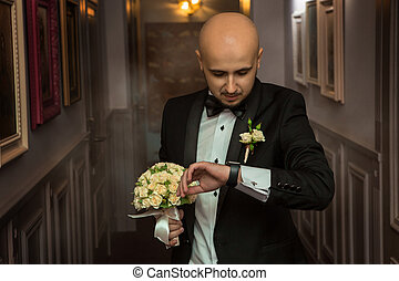 elegant young man with a bouquet of roses