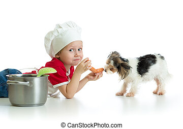 Role-playing game. Child boy playing chef with dog. -...