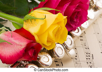 Musical arrangement with rose and silver flute
