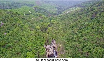 Drone Flies above Narrow Canyon among Tropical Highland -...