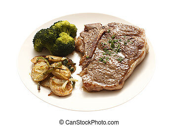 T-Bone steak dinner with sides of potatoes and broccoli...