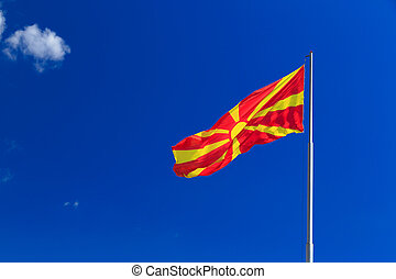 Macedonian national flag waving in the blue sky