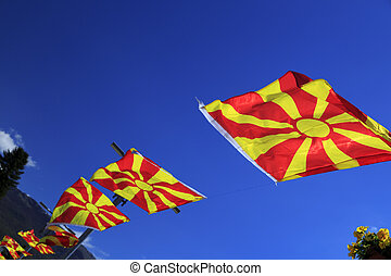 Macedonian national flags waving in the blue sky