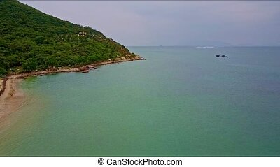 Aerial View over Quiet Azure Ocean Surface to Mountain Foot...