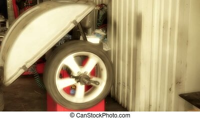 automobile wheel balancing in auto service. car repair...