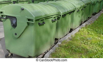 Green plastic garbage containers. UltraHD stock footage.