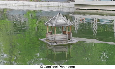 Wooden Duck House on a Pond in Rural. Video UltraHD.