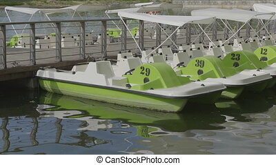 Green catamarans on the pier of a boat station. . Video UltraHD.
