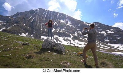 Boyfriend takes pictures of his girlfriend outdoors - Happy...