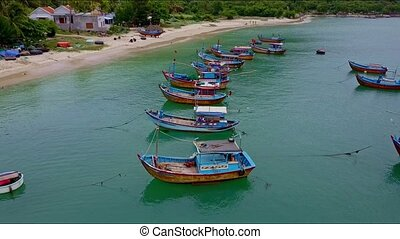 Drone Flies Slowly over Moored Fishing Boats Line by Beach -...