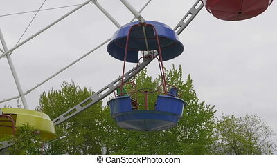 Underside view of a ferris wheel over blue sky. UltraHD...
