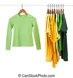 Green and yellow shirts on wooden hangers