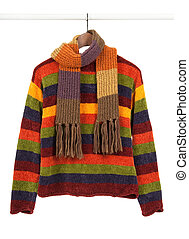 Striped colorful sweeter and scarf on wooden hanger,...