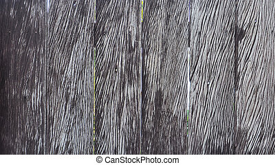The wooden sheet fence has a deep gray tread pattern - The...