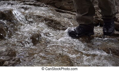 man crossing the creek, walks on the water