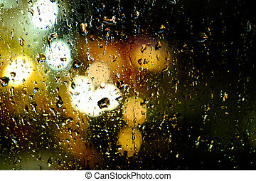 water drops on the windscreen front of the car, abstract...