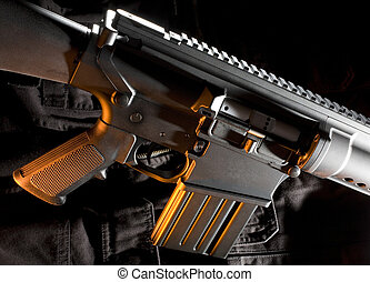 Assault rifle with orange gels that are on a tactical vest