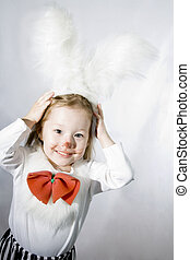 Girl in a white downy bunny costume.
