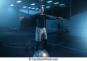 Man on training, balance workout with bouncy ball - Strong...