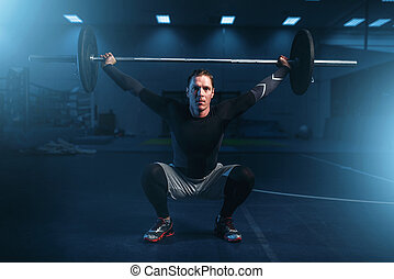 Strength athlete on training, workout with barbell