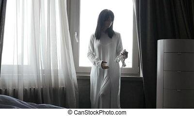 Sensual woman at window