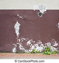 abandoned cracked stucco wall with ventilation grille -...