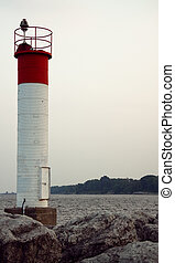 Lighthouse at harbor - Light house at Bronte Harbor with...