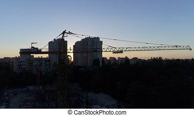 City buildings aerial sunset - Construction site with...
