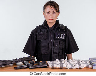 Female Asian police officer with seized goods - Female...