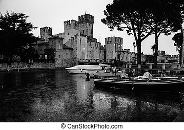 Sirmione, Italy. Illuminated Scaliger Castle in Sirmione,...