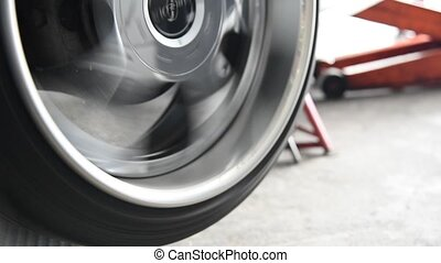 Rotating a car wheels for checking car suspension