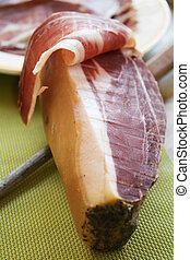 Prosciutto di Parma cut by hand - famous Italian dry-cured...