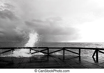 splash of sea on a wooden gangway - black and white...