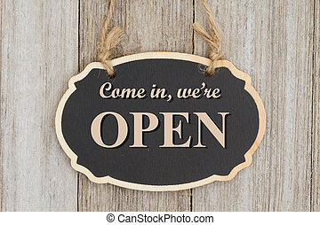 Retro come in, we're open sign - Come in we're Open text on...