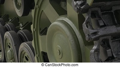 tank caterpillar closeup. Steel rusty caterpillar from the Soviet military tank. Background. Rear view of the tank t-34