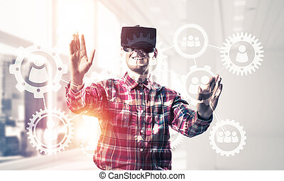 Guy wearing checked shirt and virtual mask demonstrating...