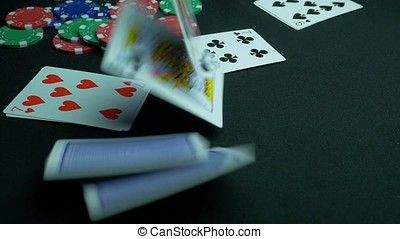 Cards falling on the table. Cards are falling on a poker...