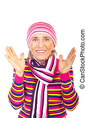 Surprised winter aged woman in pink knitted clothes isolated...
