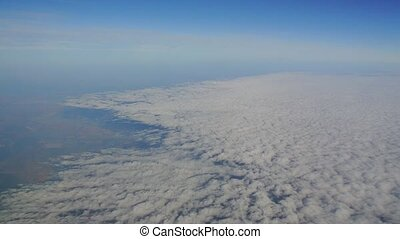 Clouds view from an airplane. Snow-white velvet clouds.