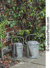 Two old watering cans in vintage style image of English...