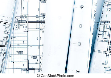 rolls of architectural blueprint plans and engineering technical drawings