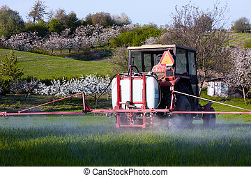 Tractor spraying on the field - Tractor spraying on the...