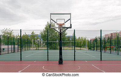 Outdoor basketball court in a public park.