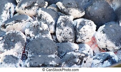 Closeup of hot gray embers with no people