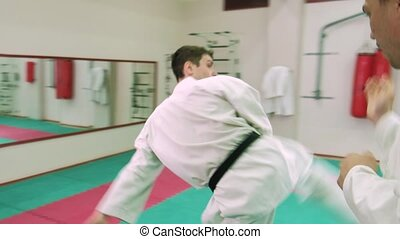 kTwo karate players compete in the ring 4k - Two karate...