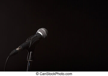 Microphone on empty black background - Photo of microphone...