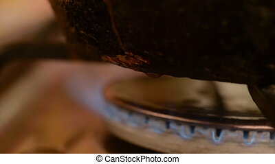 Dirty gas stove burners in kitchen room. The food boils out...